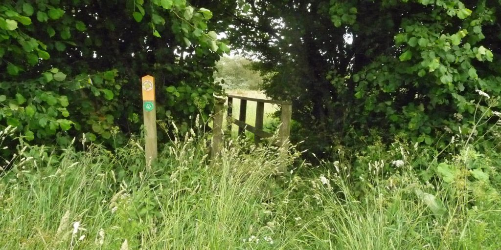 Small bridge and sign on path to Brandon Marsh Nature Reserve