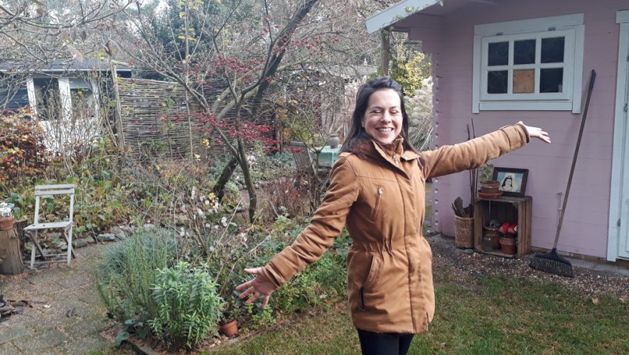 Saskia Ebeli in allotment garden with pink cottage